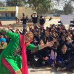 Lisa Menna performs to promote safety for women and girls in Punjab, India.