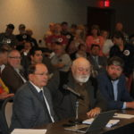 Proponents of the oil train spent hours promoting the project to the Utah Permanent Community Impact Board. Those opposed (standing in back) did not get to speak.