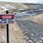 Danger sign at Utah tar sands test pit. Photo credit: Max Wilbert